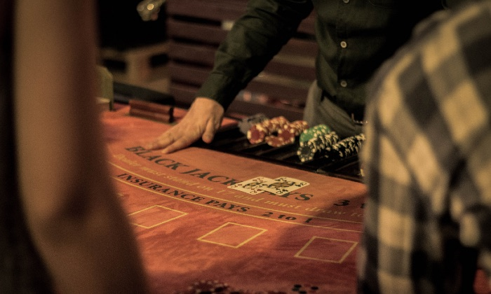 The Gambler's Playlist: 4 Songs Dedicated to Cards, Slots, Casinos and More