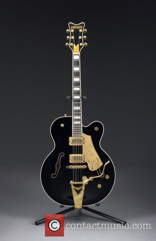 Bono's Guitar, Bob Dylan, Johnny Cash, Kurt Cobain, Miles Davis, Slash, The Edge, U2 and Bono 1