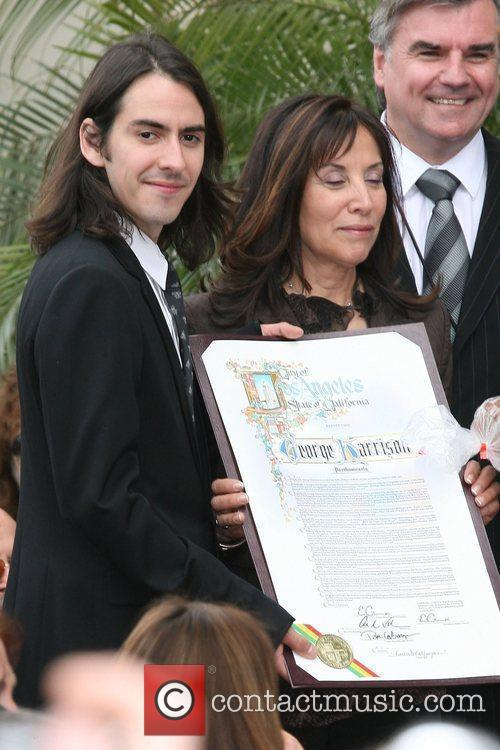 Dhani Harrison and George Harrison 1