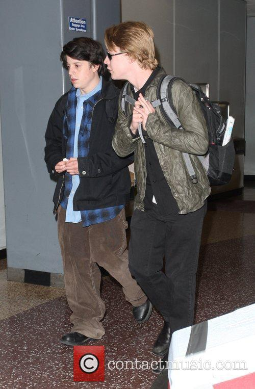 Macaulay Culkin and A Male Friend 6