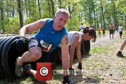 A Tough Mudder Participant Gets Through The 'boa Constrictor' Section Of The Course. 1