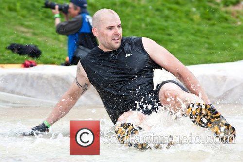 A Tough Mudder Participant Sliding Down The Slip N' Slip. 3