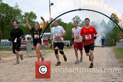 Tough Mudder Participants Cross The Finish Line. 2
