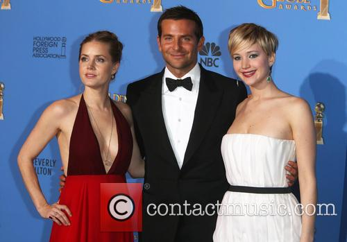 Amy Adams (r-l), Bradley Cooper and Jennifer Lawrence