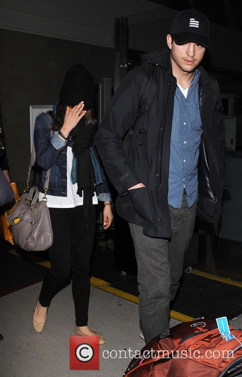 Ashton Kutcher and Mila Kunis 10