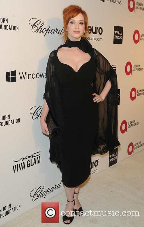 Elton John and Cristina Hendricks 7