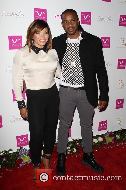 Tisha Campbell-martin and Duane Martin