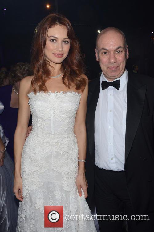 Olga Kurylenko and John Taylor