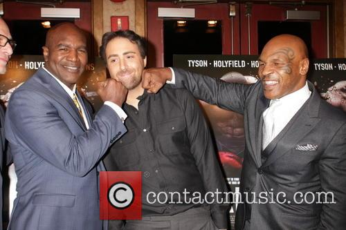 Evander Holyfield, Bert Marcus and Mike Tyson 9