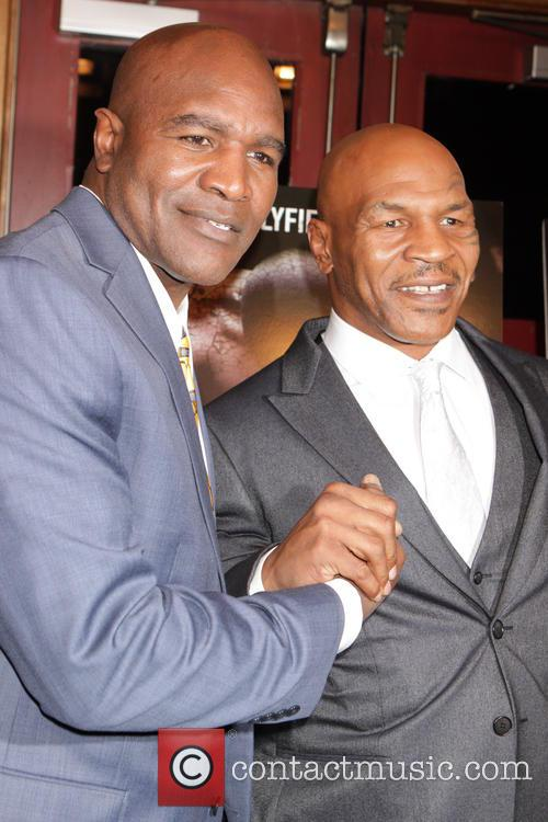 Evander Holyfield and Mike Tyson 8