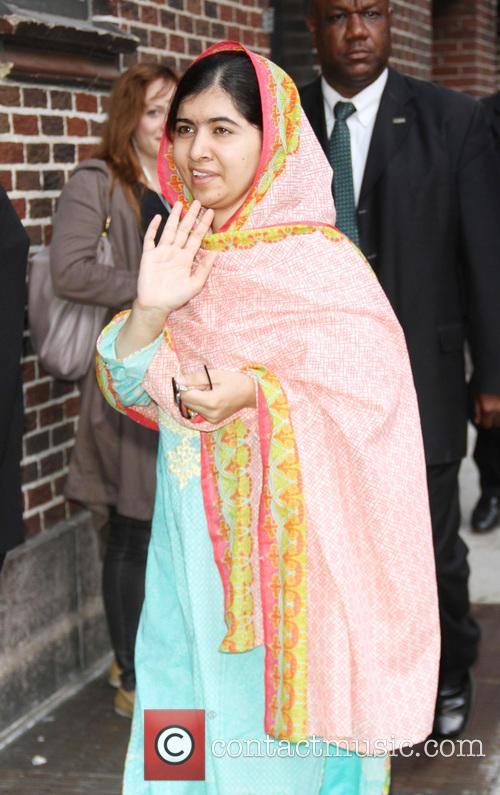 Stephen Colbert and Malala Yousafzai 6