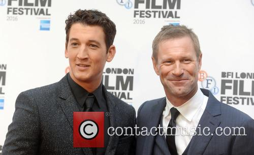 Aaron Eckhart and Miles Teller 6