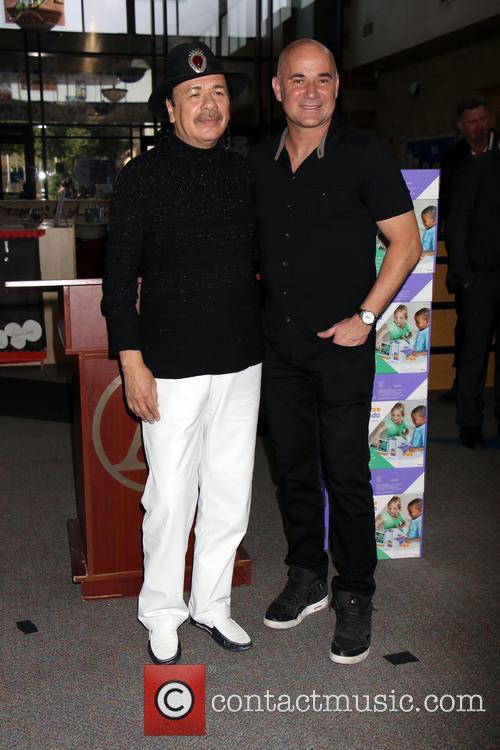 Carlos Santana and Andre Agassi 5