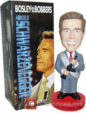 WENN PICTURE CAPTION 13 MAY 2004   ARNIE GETS TOUGH WITH BOBBLEHEAD BROTHERS ---------------------------------------------------------------------  Movie star-turned-California Governor ARNOLD...