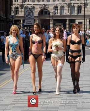 Insinuate Lingerie celebrates the launch of its new collection outside Liverpool Street station with models posing as Sex And The...