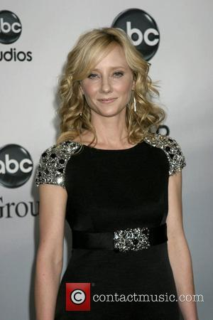 Heche's Heart Told Her 'Romance Couldn't Wait'