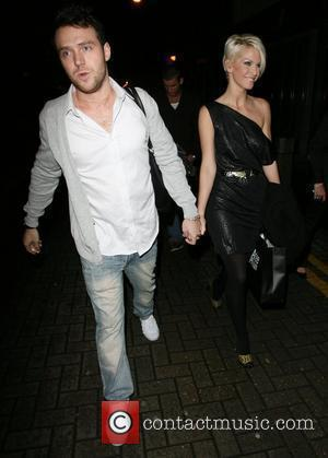 Sarah Harding and boyfriend Tom Crane. Sarah threatens not to go out partying again unless photographers stop taking pictues of...