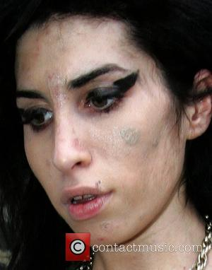 Winehouse Turns Up Late To Concert