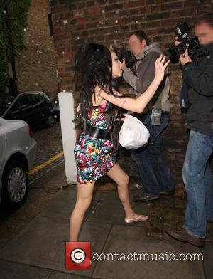 Winehouse To Stay Away From U.s.