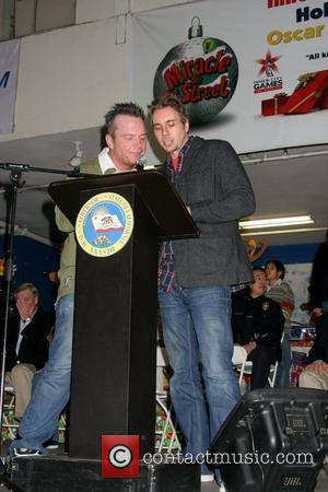 Tom Arnold and Dax Shepard The 26th Annual 'Miracle On 1st Street' toy giveaway at Hollenbeck Youth Center Los Angeles,...