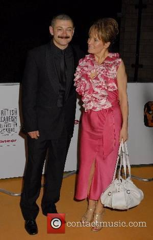 Andy Serkis and guest,  The Pioneer British Academy Television Awards at the London Palladium - Departures London, England -...