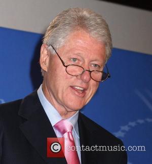 Clinton Hails Pal Douglas