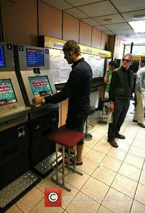 Brian McFadden placing a bet in a bookmakers in Primrose Hill London, England - 05.06.07