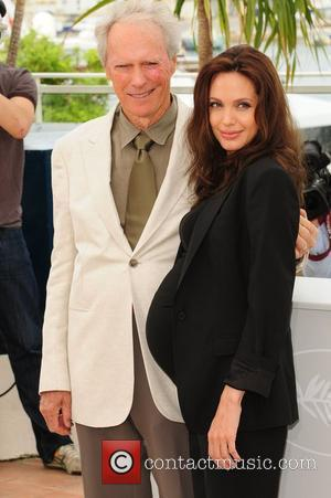 Grumpy Eastwood Leaves Wife To Apologise On Red Carpet