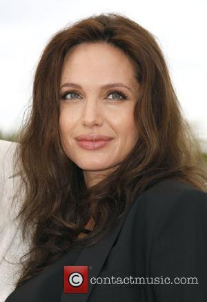 Jolie Gives Birth To Twins In France?