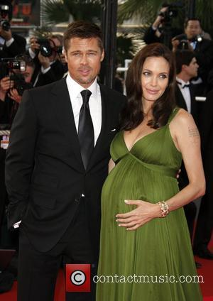 Pitt + Jolie Want To Adopt African Girl