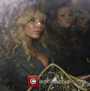 Kimberley Walsh and Sarah Harding with Nadine Coyle, who is blissfully unaware she is having a wardrobe malfunction, as her...