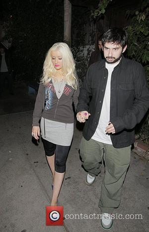 Aguilera Shows Off Baby Son