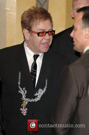 Sir Elton Wins Sculpture Battle