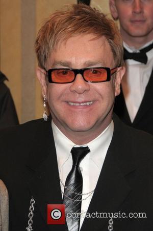 Elton John's Brooch Fails To Set Auction Alight