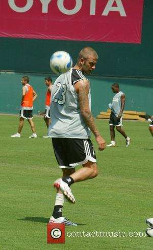 Beckham Plays Soccer In Sierra Leone