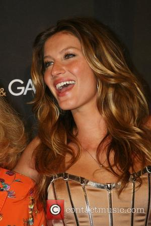 Gisele Bündchen celebrates the launch of Dolce & Gabbana's newest fragrance 'The One' at Saks Fifth Avenue New York City,...