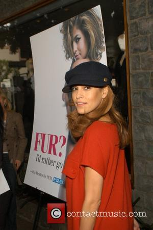 Eva Mendes unveils her PETA Ad ' Fur? I'd rather go naked ' on Robertson Boulevard - Photocall Los Angeles,...