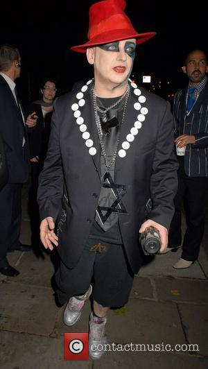 Boy George Plans Party For Bin Men