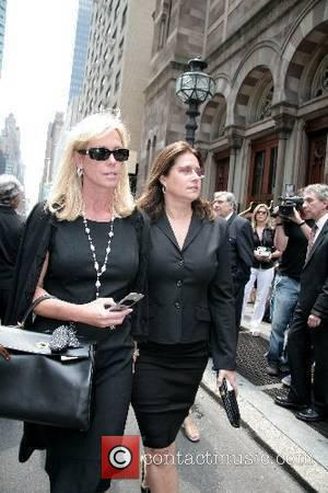 Lorraine Bracco and guest depart the funeral of Claudia Cohen held at Central Synagogue New York City, USA - 18.06.07