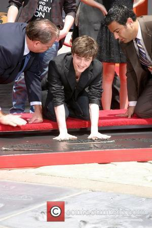 Radcliffe Struggles With Press-ups