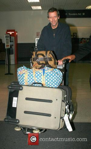 House M.D. star, Hugh Laurie arriving at LAX from London plenty of bags as he heads to getting back to...
