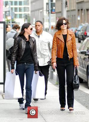 Katie Holmes with a friend and a bodyguard after shopping at The Corner at Gendarmenmarkt. She bought the brown leather...