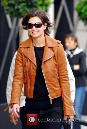 Katie Holmes after shopping at The Corner at Gendarmenmarkt. She bought the brown leather jacket she's wearing in the picture...