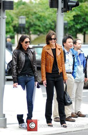 Katie Holmes with a friend after shopping at The Corner at Gendarmenmarkt. She bought the brown leather jacket she's wearing...