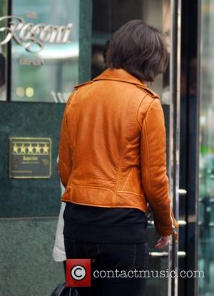 Katie Holmes arriving back at her hotel after shopping at The Corner at Gendarmenmarkt. She bought the brown leather jacket...