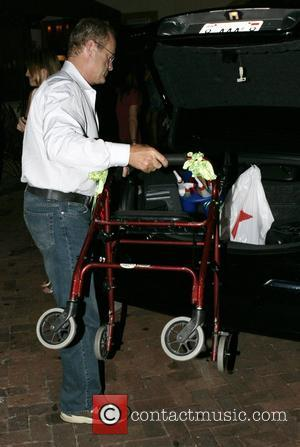 Kelsey Grammer loads his mother's zimmer frame into the car outside Nobu restaurant after having a meal with his wife...