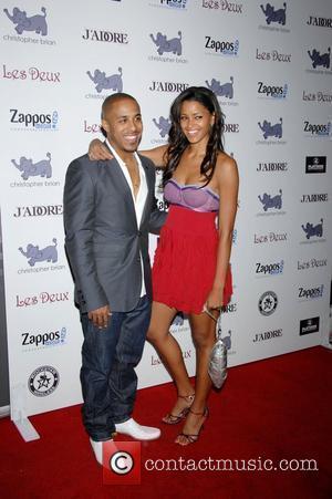 Marques Houston and Claudia Jordan