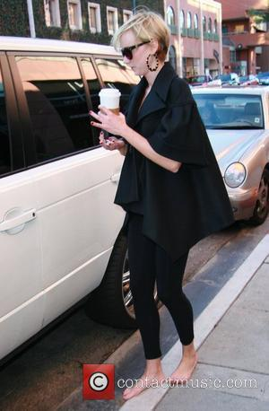 Kimberly Stewart walks barefoot to her car after getting a pedicure at a salon in Beverly Hills Los Angeles, California...