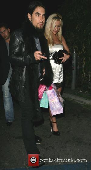 Dave Navarro and girlfriend Nicole Bennett leaving Les Deux nightclub Los Angeles, California - 03.10.07