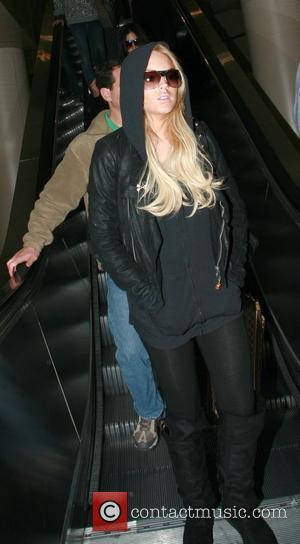 Lohan Hospitalised With Wrist Fracture